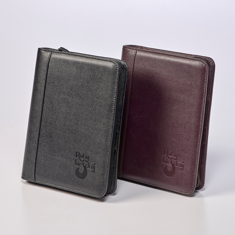 Sneller Creative Promotions - Custom Leather Planners and Organizers